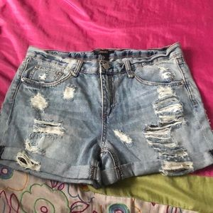 Blue Jean Ripped shorts.